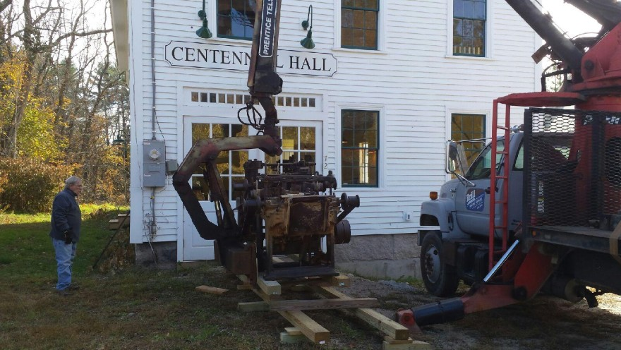Planer being off loaded in front of Centennial Hall readying for its move inside